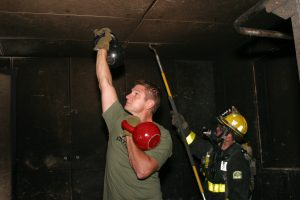 Author & Firefighter Anthony Grokaitis Presses A Kettlebell