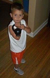 Are You Sure You Want To Work Out With The 5 Pounder? Maybe Little Jonah Can Spot You. <i>Thanks to kettlebellathleticsblog.com</i>